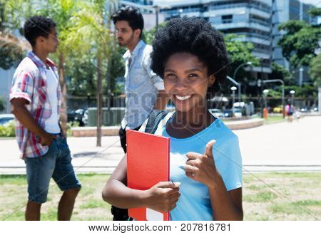 Successful african american female student on campus of university