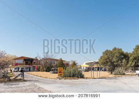 KOOPMANSFONTEIN SOUTH AFRICA - JULY 7 2017: The shopping centre and gas station in Koopmansfontein a village in the Northern Cape Province of South Africa