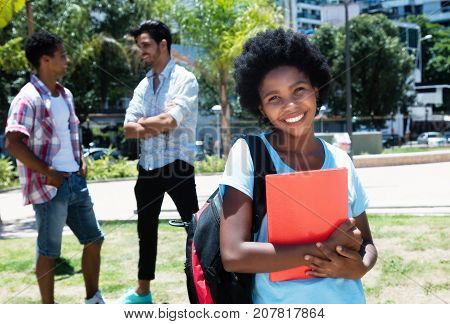 Cute african american female student on campus of university