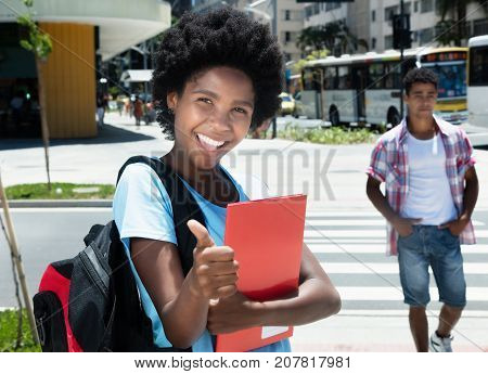 Beautiful african american female student in the city in the summer