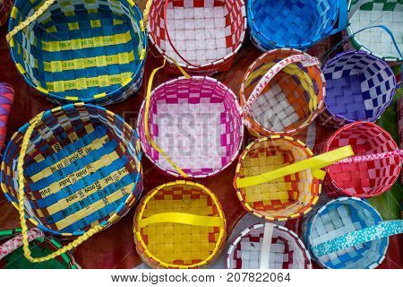 Close up of Colorful weaved plastic baskets
