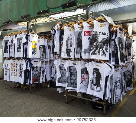London, UK: July 26, 2016: The Camden Town market stalls are famous for their funky products. This stall is selling printed t-shirts.
