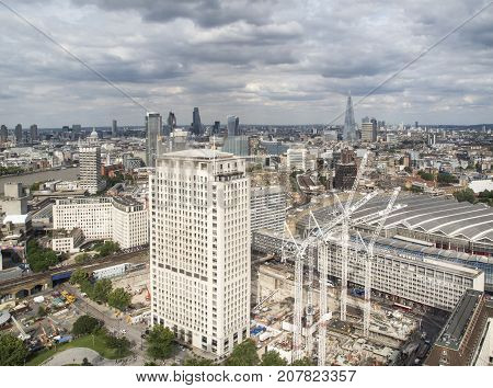 London, UK: July 25, 2016: View of the city of London with cranes and new construction to the fore.