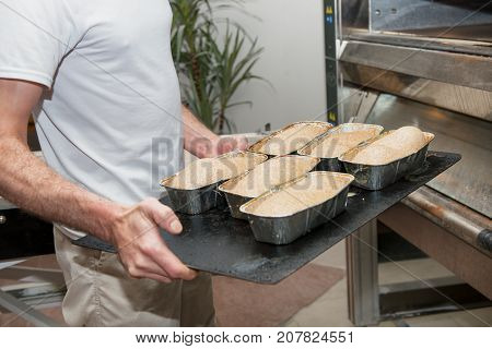 a man cooking brioches at the pastry-cook