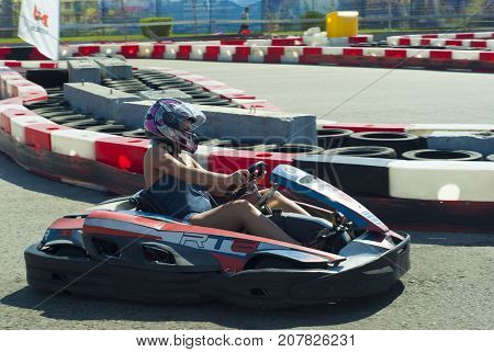 RUSSIA SOCHY - SEPTEMBER 20 2017. amateur girl in a purple helmet is racing in a rented kart on a equipped track