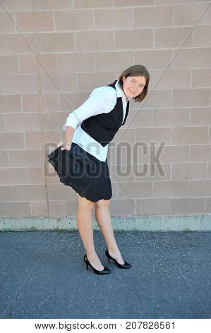 Female nanny in uniform taking a break outside.
