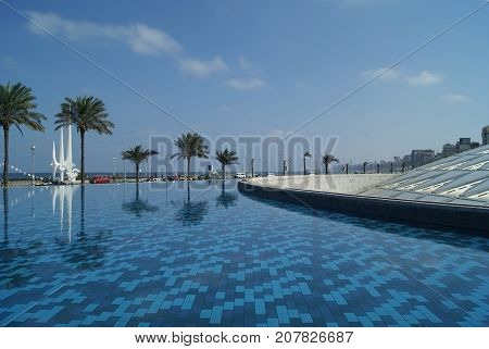 EGYPT ALEXANDRIA:- SEPTEMBER 19 2010: Pool near the building of the Bibliotheca Alexandrina. The Bibliotheca Alexandrina (Library of Alexandria) is a major library and cultural center located on the shore of the Mediterranean Sea in the Egyptian city of A