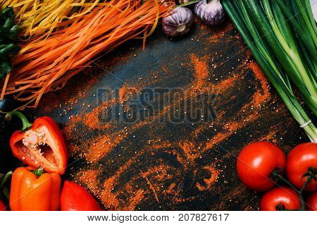 food organic vegetable tomato garlic pepper scallion pasta assortment concept