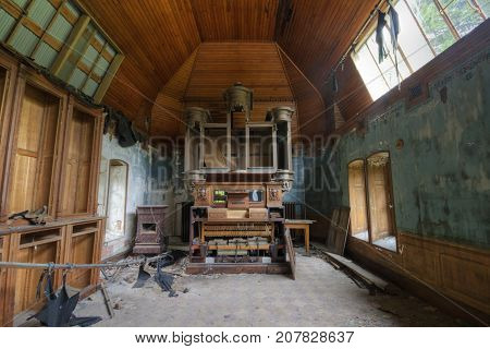 abandoned chapel with destroyed organ and pinao