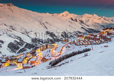 Amazing winter sunrise landscape and ski resort with typical alpine wooden houses in French Alps Les Menuires 3 Vallees France Europe