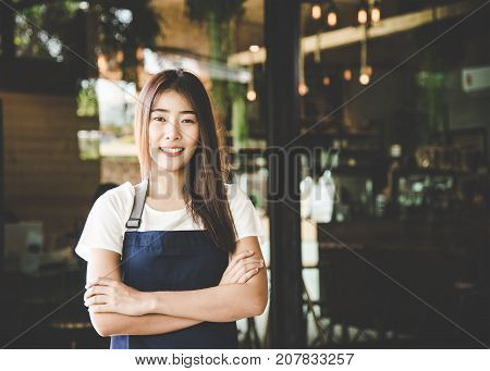 Barista asian women Cafe Making Coffee Preparation. Service Concept