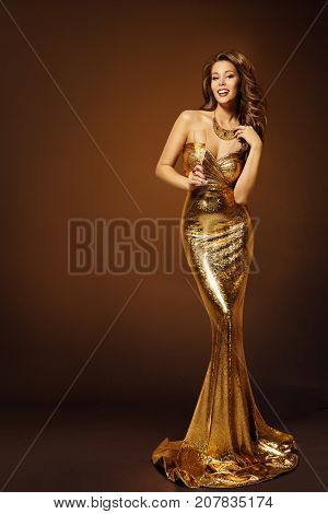 Fashion Model Gold Dress Woman in Beauty Golden Gown with Champagne Lady in Long Clothes