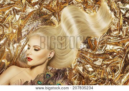 Fashion Model Hairstyle and Beauty Makeup Woman Waving Golden Color Hair Style and Beautiful Make Up Gold Fabric Background