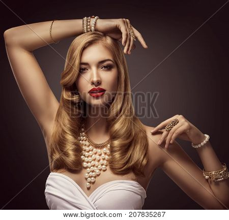 Woman Beauty Portrait Fashion Model posing Jewelry necklace bracelet Elegant Lady Makeup over Black Background