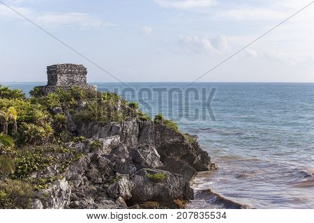 maya ruins in tulum mexico with clouds