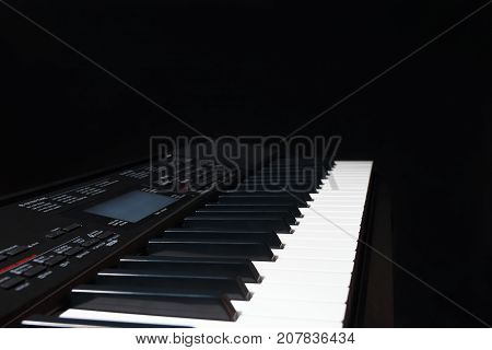 The electronic organ on a black background
