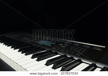 Keyboard of the synthesizer on a black background