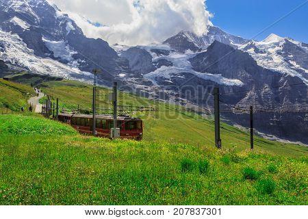Famous red train from Kleine Scheidegg to Jungfraujoch (Top of Europe) in summer. Kleine Scheidegg Bernese Oberland Switzerland