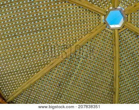 Modern design pergola arbor made wood with clear blue summer sky background roof wooden arbor
