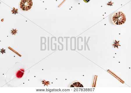 Mulled wine ingredients on white background. Flat lay top view Christmas or New Year holiday concept with space for text.