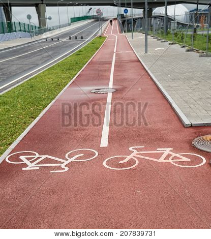 Two-way bicycle lane with red coating outdoors