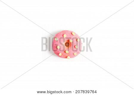 One donut. Minimal flat lay concept background