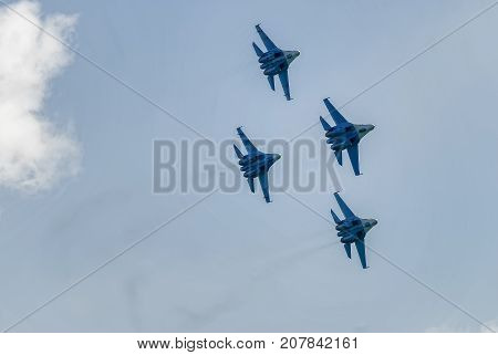 Nizhniy Tagil Russia - July 12. 2008: Group flight of russian highest pilotage team on SU-27. Display of fighting opportunities of equipment with application of aviation means of defeat