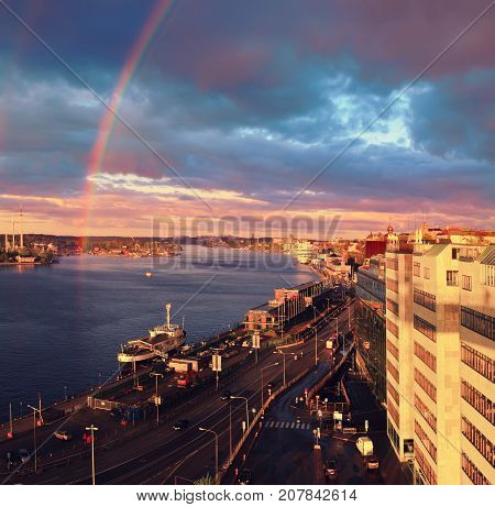 Beautiful sunset with rainbow and dark blue sky over the Stockholm - the capital of Sweden
