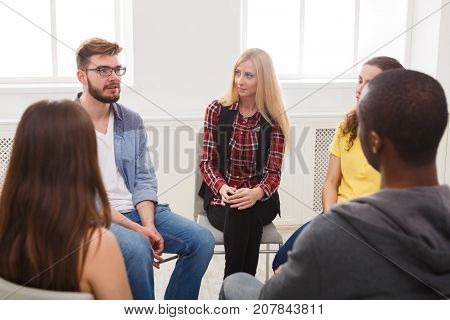 Meeting of support group. Young woman therapist listening to other people. Mental health, psychotherapy concept
