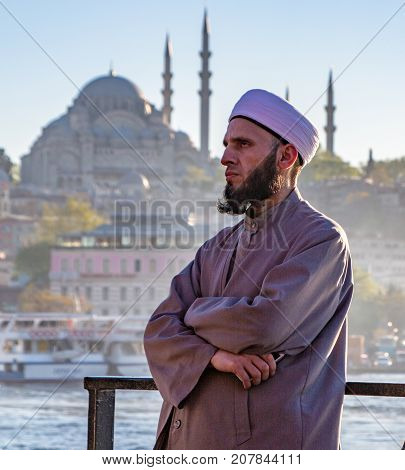 Conservative Islamic Man With Iphone On Ferry And Blue Mosque In The Background