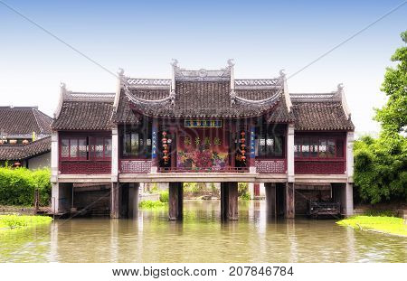 August 8 2015. Xitang Town china. The landmark Xitang's ancient stage above the water canals of xitang town in Jiashan county in zhejiang province china.