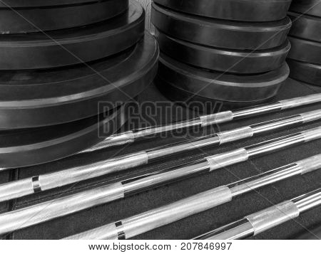 Disassembled barbell on floor in gym. Sports equipment