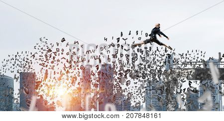 Business woman jumping over gap with flying letters in concrete bridge as symbol of overcoming challenges. Cityscape with sunlight on background. 3D rendering.