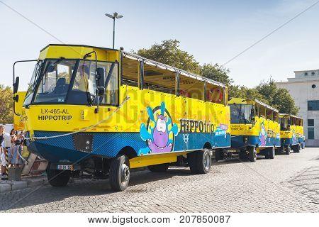 Yellow Blue Amphibian Buses In Lisbon