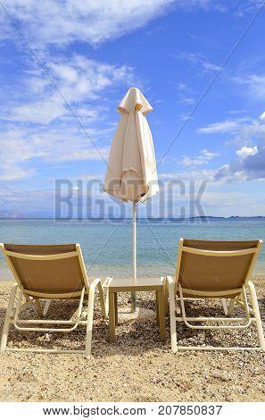 Sun loungers on Ipsos Beach in Corfu