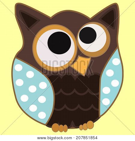 Brown Owl With Blue Wings In Speckles And Centered Eyes