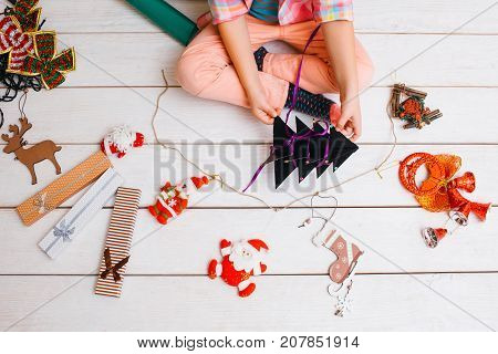 Preparation for Christmas. Art decoration. Favorite time of year, unrecognizable child artist on white background, creative presents creation top view, festivity concept