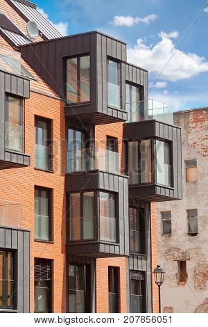 Contemporary Residential Building Exterior in the Daylight with modern balcony and brick facade