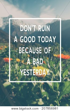 Inspirational and motivational quotes - Don't ruin a good today because of a bad yesterday. Blurry retro style background.