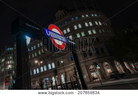 London, UK. 29th September 2017. A night capture of a subway entrance to Charing Cross tube station by Trafalgar Square.