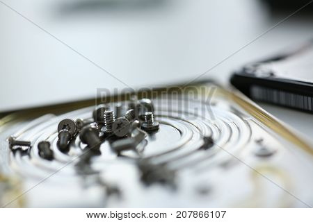 Small bolts removed macro in repair shop to restore micro engineering background