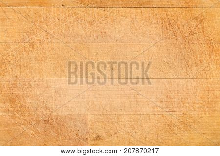 Old aged scratched chopping cutting board wooden background