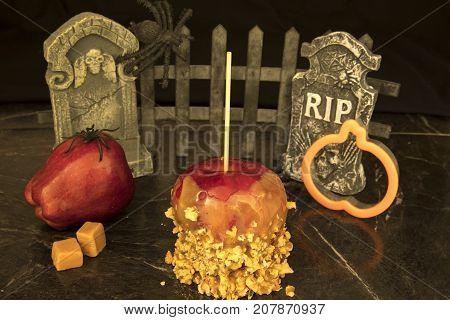 Caramel Apple With Tombstones And Pumpkin