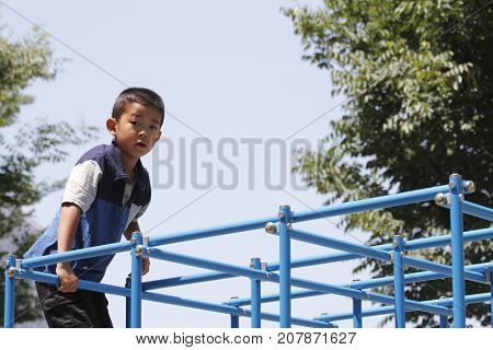 Japanese Boy On The Jungle Gym (second Grade At Elementary School)