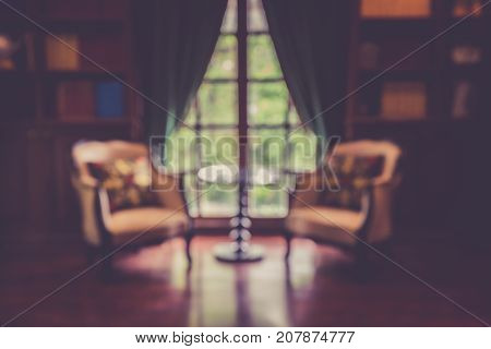 Blurred abstract background of book shelves row and interior of library with textbooks.