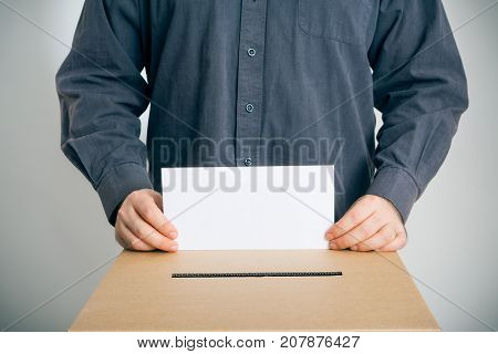 man casting his vote. blank envelope on which you can place your own text.