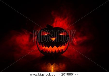 Halloween - Old Jack-o-lantern On Black Background. Spooky Halloween Background With Pumpkin