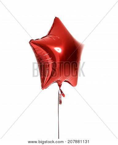 Single big red star balloon object for birthday  party isolated on a white background