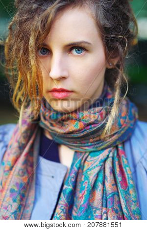 Wonderful portrait of a cute charming girl Slav on blurred background in the street in autumn closeup