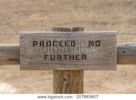 Proceed No Further Sign at the end of a trail